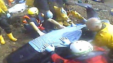 Rescuers involved in the operation to refloat the stranded whales