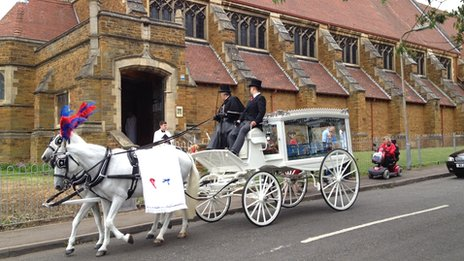 A horse drawn carriage at Dylan Cecil&#039;s funeral