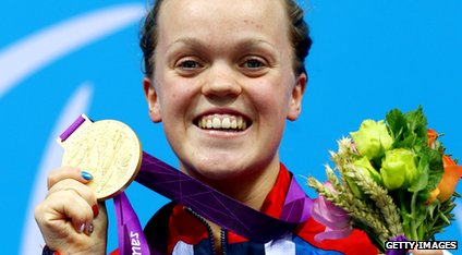 Ellie Simmonds holds up her second gold medal