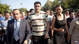Ramil Safarov, centre, walks in the Martyrs' Alley national memorial in Baku. 31 Aug 2012