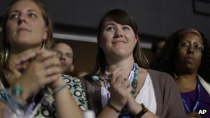 Women listen to Michelle Obama the the Democratic National Convention