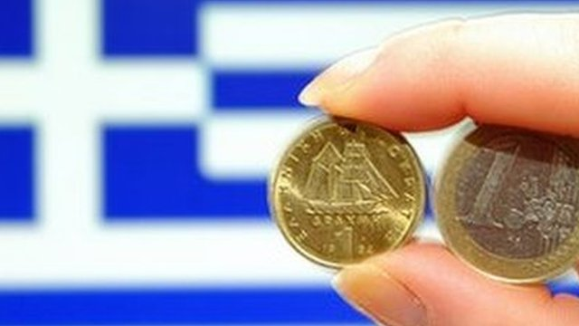 Euro and drachma coins plus Greek flag
