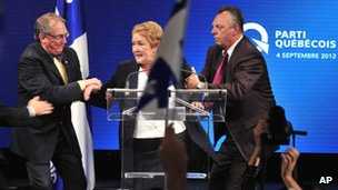 Pauline Marois is taken off the stage at PQ rally after shooting incident