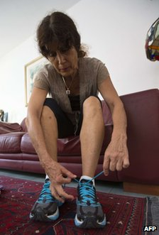 Esther Roth-Shachamorov ties her shoes at  at her home in Ramat Hasharon near Tel Aviv, Israel, 4 September