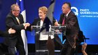 Pauline Marois being led from the stage