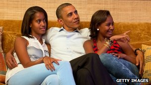 US President Barack Obama and his daughters Malia (left) and Sasha watch First Lady Michelle Obama's speech on TV, in the Treaty Room of the White House on 4 September 2012