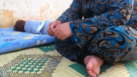 A displaced Syrian woman child in Damascus