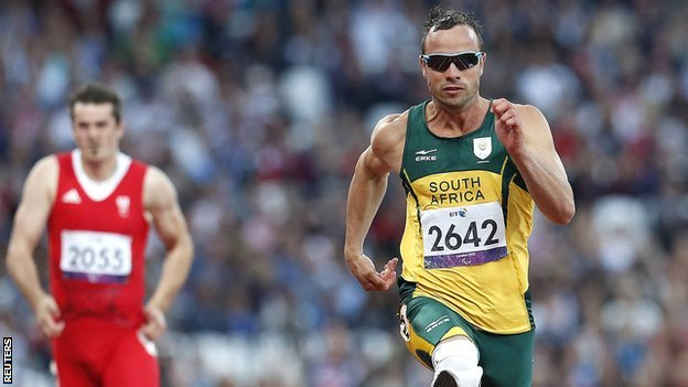 South Africa's Oscar Pistorius (right) wins his men's T44 100m heat