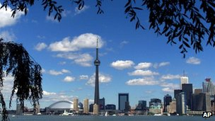 The CN Tower and the Skydome highlight the Toronto skyline in his undated file photo.
