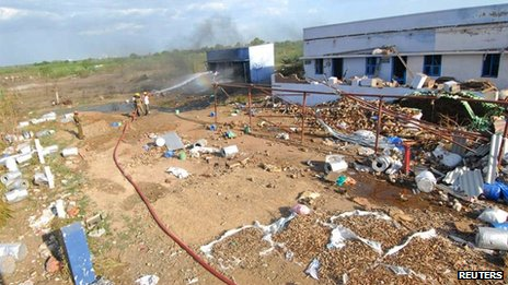 Firefighters work at the scene of a fire at a fireworks factory at Sivakasi town, about 540 km (335 miles) southwest of the southern Indian city of Chennai September 5, 2012