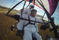 Russian President, Vladimir Putin, flies in a motorized hang glider