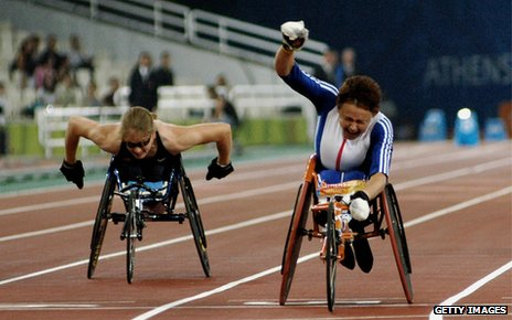 Tanni Grey-Thompson (right) crosses finishing line at Athens Paralympics, 2004
