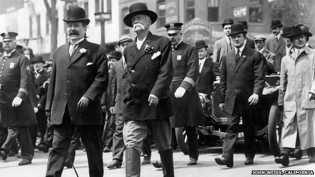 Edward Payson Weston walking in 1910 accompanied by police and minders