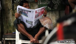 Newspaper reader, Burma, 2012