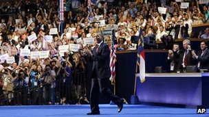 President Barack Obama walks out on stage to greet former President Bill Clinton at the Democratic National Convention