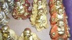 BBC Religion&Ethics - Blackpool, little statues of laughing Buddhas
