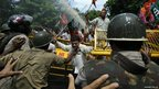 Supporters of India's main opposition Bharatiya Janata Party (BJP) shout slogans during a demonstration