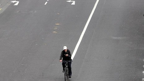 A cyclist in a car-free road (Photo: Cathal McNaughton/PA)