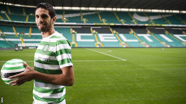Lassad Nouioui tries on his new strip at Celtic Park