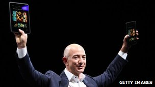 Jeff Bezos holds Kindle Fire HD tablets