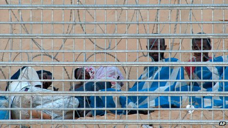 Eritrean migrants stranded at Israel's border with Egypt on Thursday - they are at the centre of a row over asylum