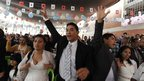 Inmates and their wives attend a mass wedding ceremony at the Lurigancho men's prison in Lima, Peru.