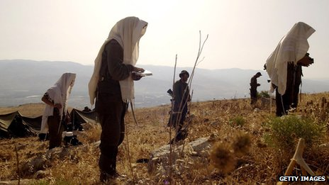 Ultra-Orthodox Jewish volunteers wear prayer shawls during survival training at an unidentified base