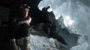 Hazel Barton sitting in a cave