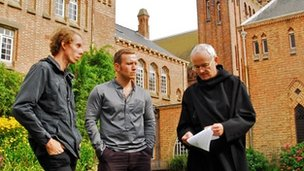 The interns with Father Luke, discussing the daily routine