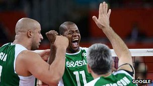 The Brazil's sitting volleyball team celebrate a point