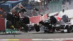 Fernando Alonso of Ferarri and Lewis Hamilton of  McLaren collide and crash