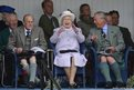 Prince Philip, Queen Elizabeth and Prince Charles, cheer as competitors participate in a sack race