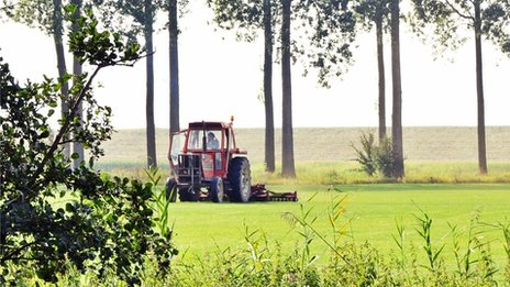 A tractor tending land in Zeeland province, south-western Netherlands