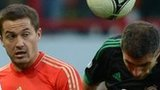 Russia's Viktor Fayzulin in action against Northern Ireland defender Aaron Hughes