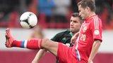 Aaron Hughes challenges Viktor Faizulin in the qualifier
