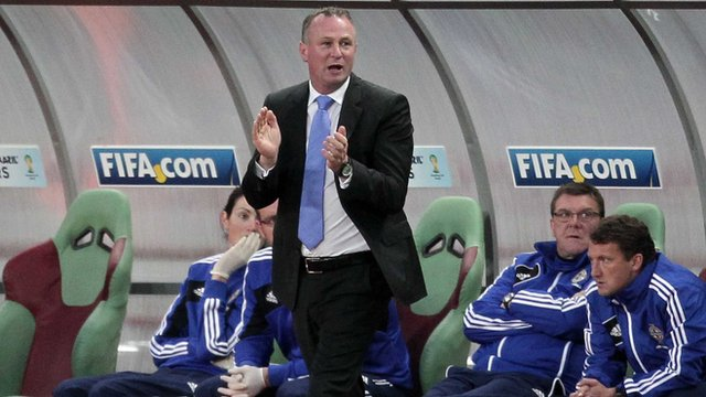 Michael O'Neill encourages his Northern Ireland team in Moscow