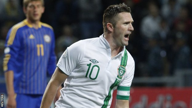 Robbie Keane celebrates after scoring his penalty in Astana