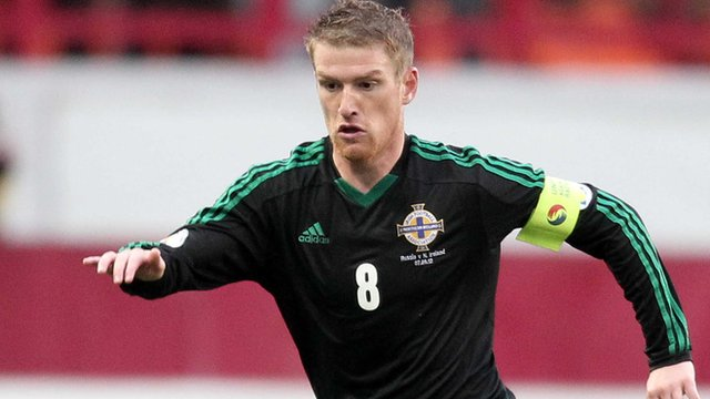 Steven Davis in action against Russia