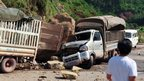 Damaged vehicles in Zhaoton, Yunnan. Photo: 7 September 2012
