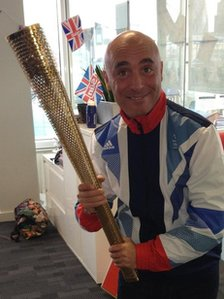 Tony with the Olympic torch