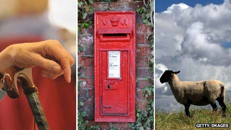Elderly woman's hands, post box and sheep