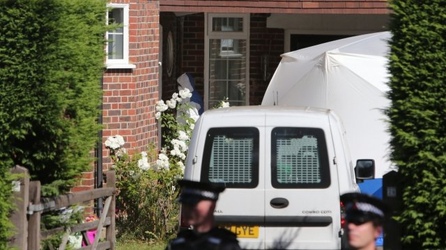 Forensics and police at al-Hilli house