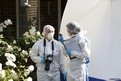 British forensic conduct investigations outside the house in Claygate, Surrey, belonging to a man shot dead in the French Alps along with his wife and two others