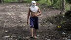 A youth covers his face from volcanic ash in Chonco. Photo: 8 September 2012