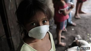 A girl in Chonco wears a mask to protect herself from volcanic ash. Photo: 8 September 2012