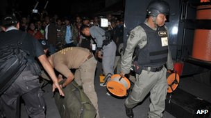 Indonesian bomb squad police officers preparing to secure the scene of a blast in the town of Depok, in the outskirts of Jakarta