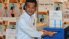 Hong Kong Chief Executive Leung Chun-ying poses for photographers as he casts his ballot at a polling station during legislative council elections in Hong Kong 9/9/12