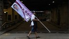 A man carries a campaign banner ahead of legislative council elections in Hong Kong 9/9/12