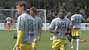 iLIVEiGIVE T-shirts worn by Torquay United players