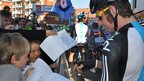 Bradley Wiggins signs a drawing of him for two fans in Ipswich
